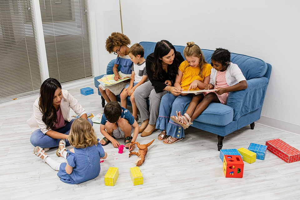 Group reading and playing on floor
