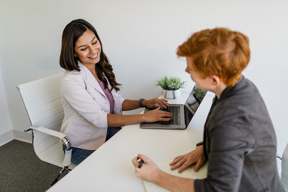 Two women meeting at desk
